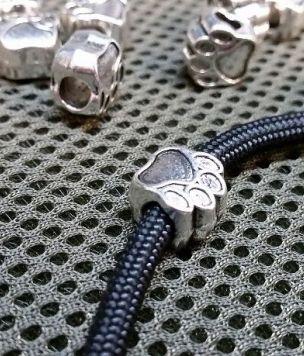 Metalowy koralik Łapa