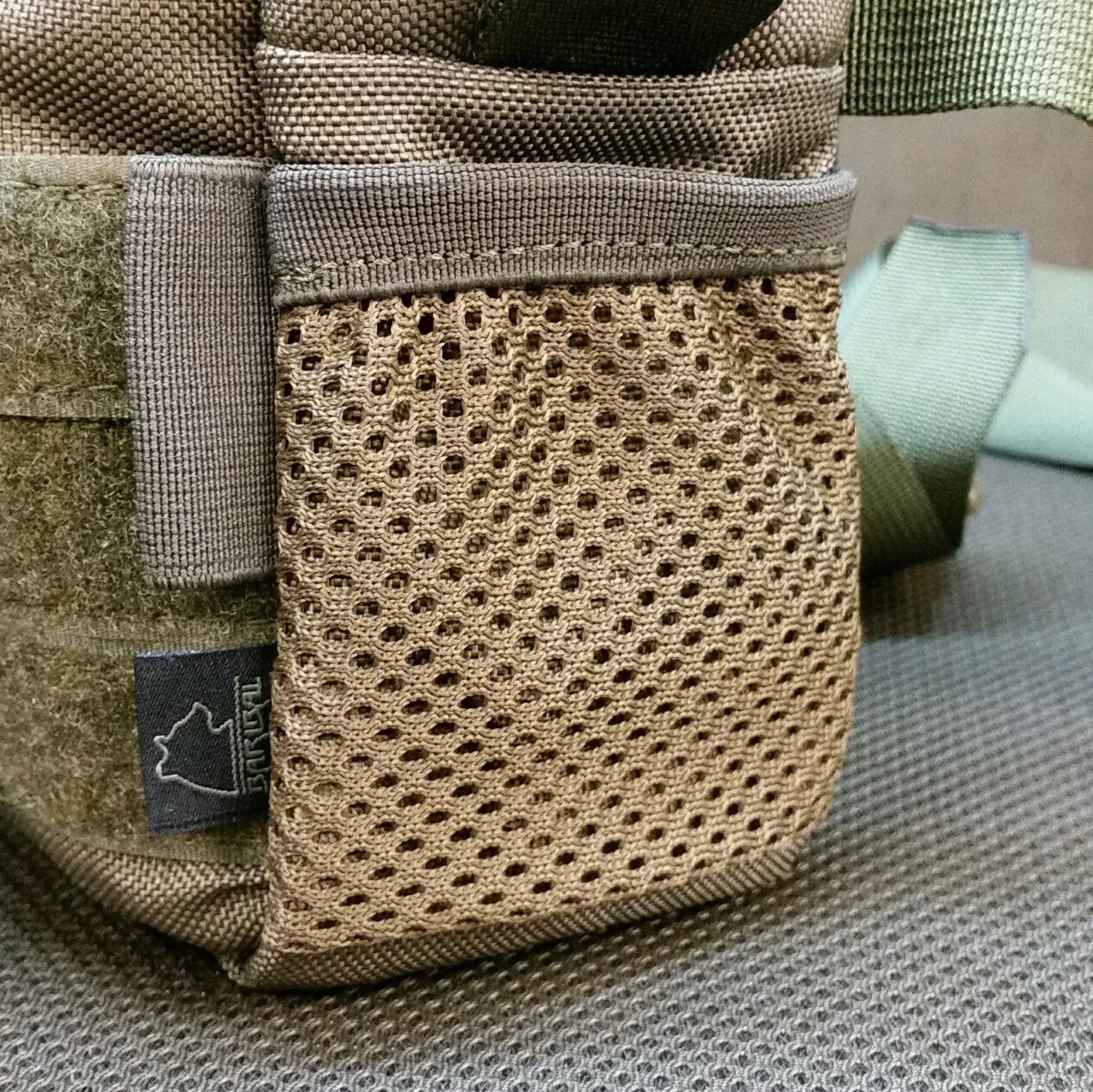 Mesh pocket instead of shockcord loops on the right side (looking at front) +7pln