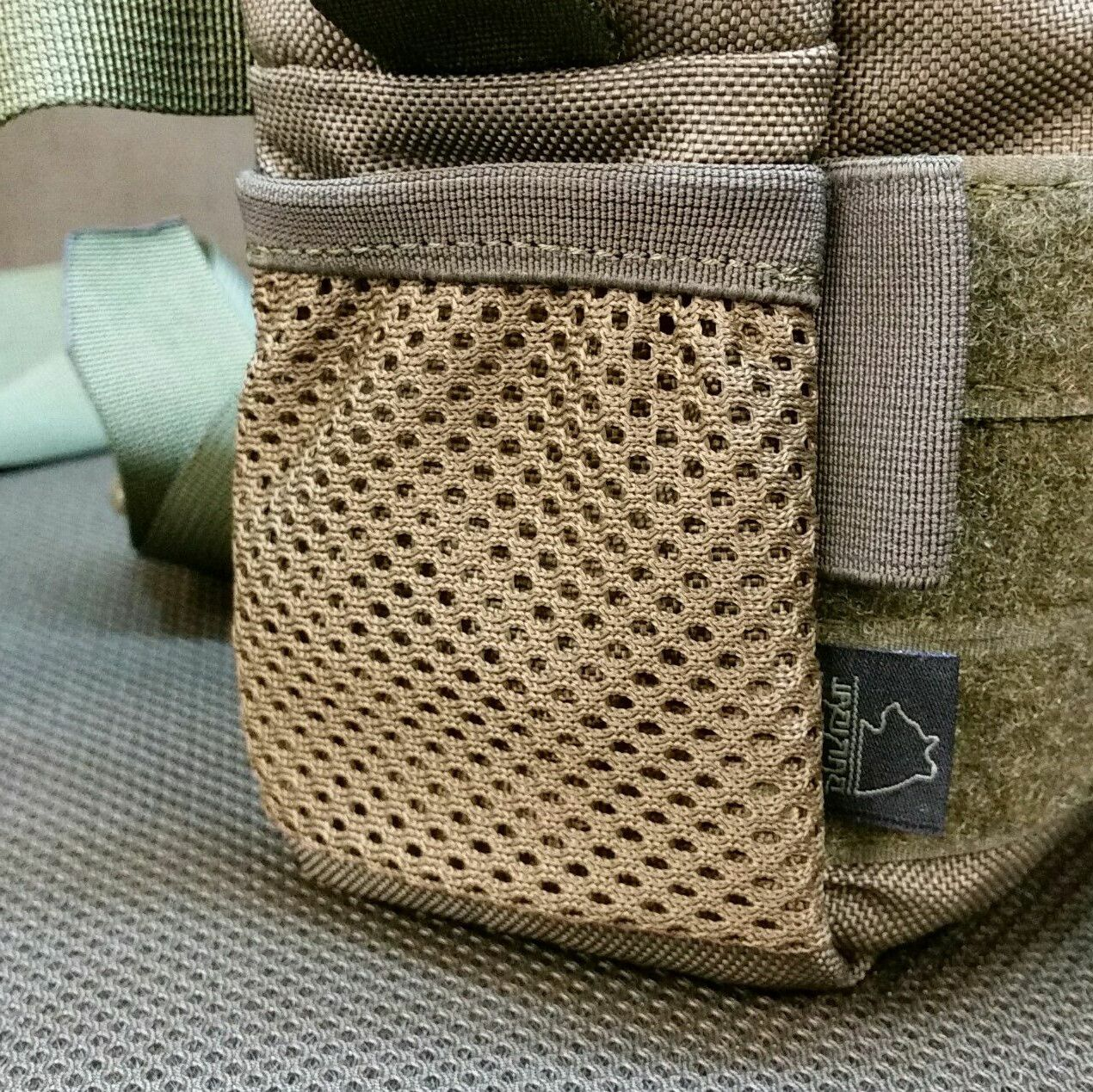 Mesh pocket instead of shockcord loops on the left side (looking at front) +7pln